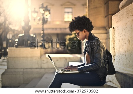 Using technology outdoors - stock photo