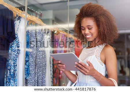 Using technology to find the best shopping deals - stock photo