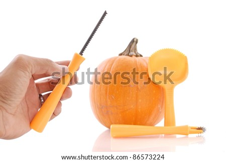 Using the Right Tool to Carve the Pumpkin - stock photo