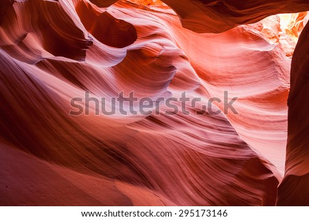 Using water and wind, Mother Nature has carved out beautiful abstract features inside of colorful sandstone canyons in the American Southwest. - stock photo