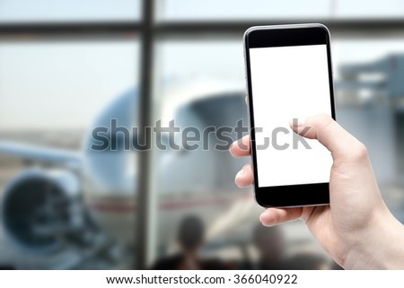 Using your phone at the airport by a woman, a blank screen isolated with space for copy - stock photo