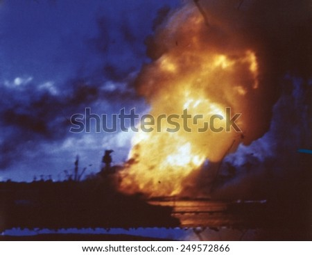 USS Arizona explodes at Pearl Harbor after Japanese attack, Dec. 7, 1941. - stock photo