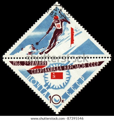 USSR - CIRCA 1966: A post stamp printed in USSR shows slalom, devoted to the Winter Games of people of the USSR, series, circa 1966 - stock photo