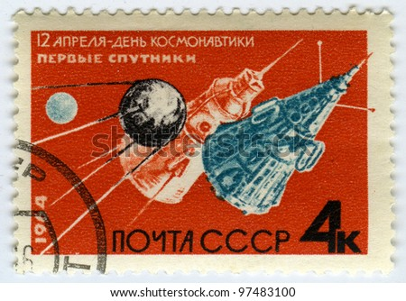 USSR - CIRCA 1964:  A postage stamps printed in USSR shows Soviet sputnik, circa 1964 - stock photo
