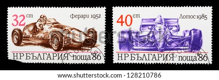 USSR - CIRCA 1986: A set of postage stamps printed in USSR shows historic sport car, series, circa 1986 - stock photo
