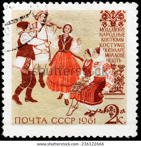 USSR - CIRCA 1961: A stamp printed by USSR (Russia) shows Moldovan traditional and historic clothing, circa 1961 - stock photo