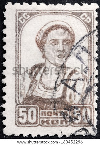 USSR - CIRCA 1929: A stamp printed by USSR (Russia) shows portrait of peasant women against white background, circa 1929. - stock photo