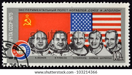 """USSR - CIRCA 1975: A Stamp printed in the USSR shows experimental flight of the ships """"Union"""" and """"Apollo"""", circa 1975 - stock photo"""