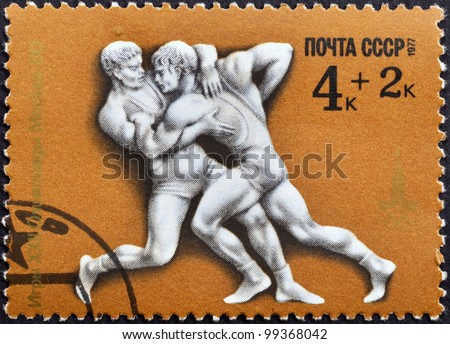 USSR - CIRCA 1977: A stamp printed in the USSR shows Games XXII Olympiad Moscow 1980-fight, circa 1977 - stock photo