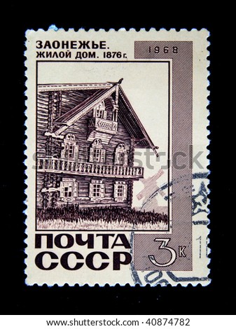 USSR - CIRCA 1968: A stamp printed in the USSR shows Living house from logs in Zaonezjie, Karelia, Russia, circa 1968