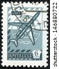 USSR - CIRCA 1976: A stamp printed in the USSR shows old plane TU - 154, globe and airmail envelope, circa 1976 - stock photo