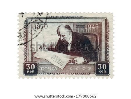 USSR - CIRCA 1945: A stamp printed in the USSR, shows portrait of communist leader Lenin (Ulyanov) reading a newspaper Pravda, circa 1945 - stock photo