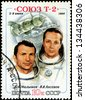 USSR - CIRCA 1980: A stamp printed in the USSR shows Soviet cosmonauts Malyshev and Aksenov and spacecraft Soyuz T-2, circa 1980. Big space series - stock photo