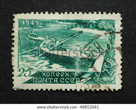USSR - CIRCA 1949: A Stamp printed in the USSR shows the competitions on kayaks, circa 1949