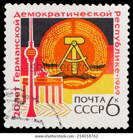 USSR - CIRCA 1969: A stamp printed in the USSR shows 20 years of German demakraticheskoy Republic, circa 1969