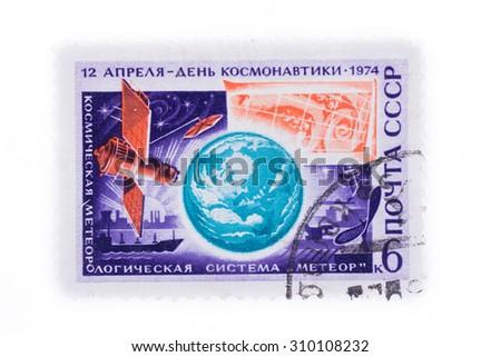 "USSR - CIRCA 1974: A stamp printed in USSR from the Kosmycheskaya meteorolohycheskaya system ""Meteor"" 12 aprelya- Cosmonautics Day 1974 - stock photo"