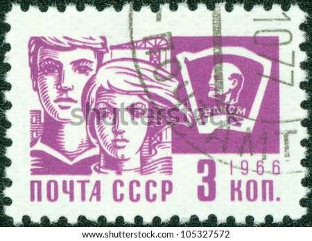 "USSR - CIRCA 1966: A stamp printed in USSR from the ""Society and Technology"" issue shows a young boy and girl and Lenin emblem, circa 1966. - stock photo"