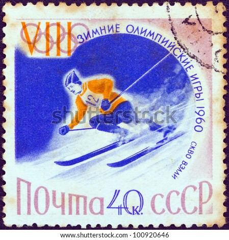 """USSR - CIRCA 1960: A stamp printed in USSR from the """"Winter Olympic Games, Squaw Valley, California"""" issue shows a Alpine skiing athlete, circa 1960. - stock photo"""