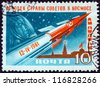 "USSR - CIRCA 1961: A stamp printed in USSR from the ""World's First Manned Space Flight"" issue shows Rocket, Gagarin and Kremlin. Inscribed 12-IV-1961, circa 1961. - stock photo"