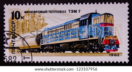 USSR - CIRCA 1982: A stamp printed in USSR shows a blue train on a rails, circa 1982.