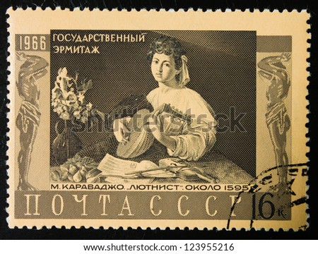 USSR - CIRCA 1966: A stamp printed in USSR shows painting by Caravaggio-Lute Player- from the Hermitage collection, circa 1966.