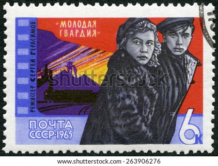 "USSR - CIRCA 1965: A stamp printed in USSR shows Scene from Film ""Young Guard"", 1948, circa 1965 - stock photo"
