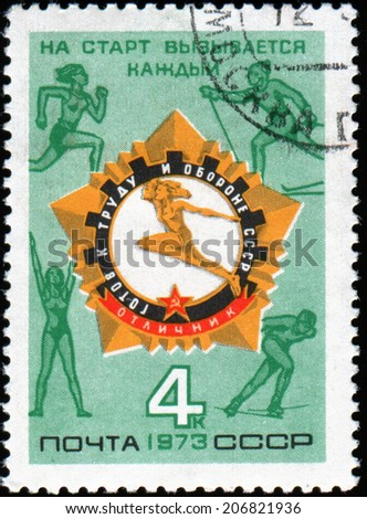 "USSR - CIRCA 1973: a stamp printed in USSR shows Soviet logo of excellence standards ""Ready for labor and defense"", circa 1973 - stock photo"