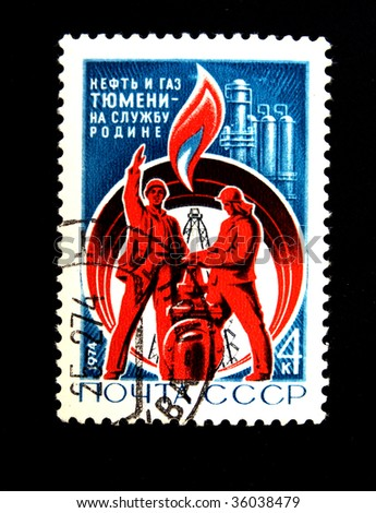 USSR - CIRCA 1974: A stamp printed in USSR Shows two workers on a background of an oil derrick, the pipeline and an oil refining factory, have inscript cruid oil and natural gas of Tumen, circa 1974. - stock photo
