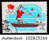 USSR - CIRCA 1976: A stamp printed in USSR, Summer Olympics in Montreal, canoeing, athlete is swimming in a boat with a paddle, circa 1976 - stock photo