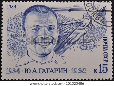 USSR - CIRCA 1984: An airmail stamp printed in USSR shows a spaceman: U.Gagarin 1934-1968, series, circa 1984. - stock photo