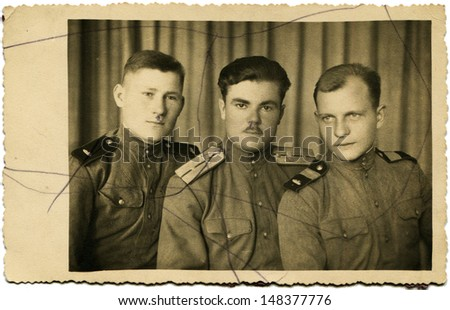 USSR - CIRCA May 24, 1946: Vintage photo shows soldier, leutenant and serjant of Soviet Army, Svazhents city, May 24, 1946 - stock photo