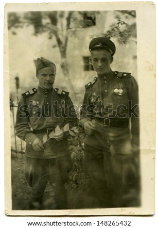 USSR - CIRCA May 12, 1946: Vintage photo shows two soldiers, May 12, 1946 - stock photo
