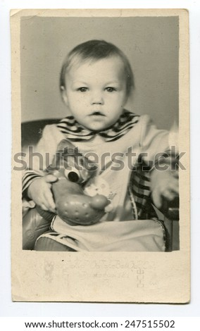 Ussr - CIRCA 1970s: An antique Black & White photo show baby with toy - stock photo
