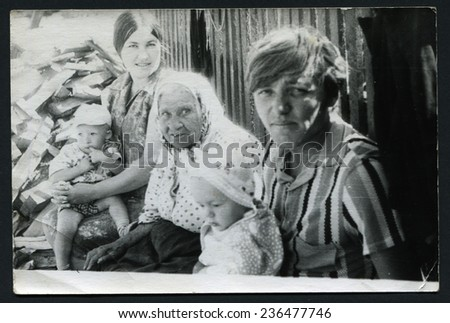 Ussr - CIRCA 1970s: An antique Black & White photo show family sitting on a bench