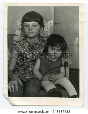 Ussr - CIRCA 1980s: An antique Black & White photo show two little girl - stock photo