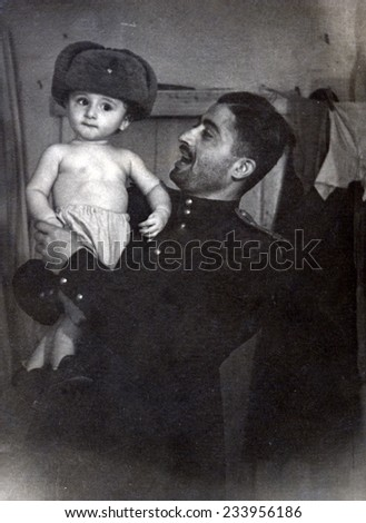 Ussr - CIRCA 1955s: An antique photo shows a father and his son. - stock photo