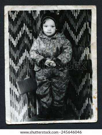 USSR - CIRCA 1960s: An antique photo shows little girl on a chair, circa 1960s - stock photo