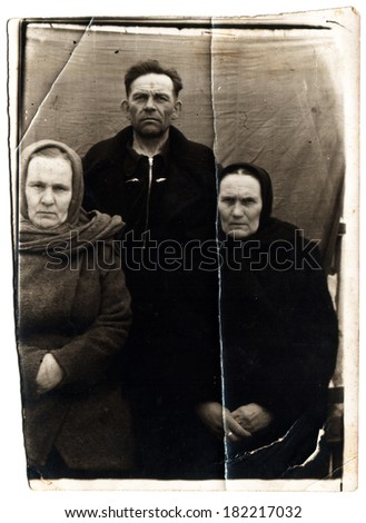 USSR  - CIRCA 1950s: An antique photo shows man and two women
