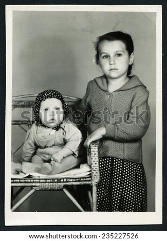 USSR - CIRCA 1960s: An antique photo shows studio portrait of older and one younger sister - stock photo