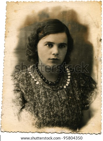 USSR - CIRCA 1950s: Studio portrait of a young woman with beads, circa 1950s