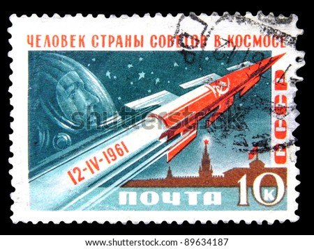 "USSR - CIRCA 1961: stamp printed in the USSR(Russia) shows rocket, astronaut with the inscription ""Man from the Soviets country in Space"" from the series ""World's first manned space flight"",circa 1961 - stock photo"