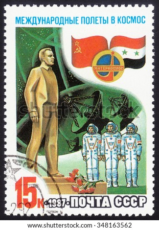 USSR - CIRCA 1987: Stamp printed in USSR - International partnership between Soviet Union and Syria in space, circa 1987 - stock photo