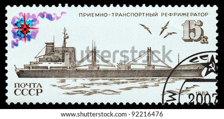USSR - CIRCA 1983: the stamp printed on USSR shows a transporting refrigerator, circa 1983 - stock photo