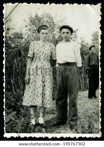 USSR - CIRCA 1951: Vintage photo shows Boy and girl in the garden, 1951