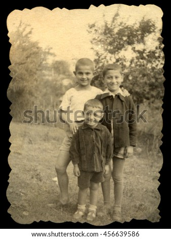 USSR, Russia, - CIRCA 1934: An antique black & white photo of three little boys