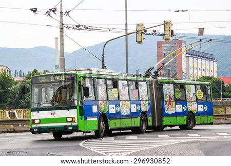 USTI NAD LABEM, CZECH REPUBLIC - JULY 21, 2014: Green articulated trolleybus Skoda 15Tr13/6M at the city street. - stock photo