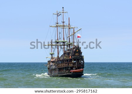 """USTKA - JULY 07: Pirate touristic ship """"Dragon"""" on the Baltic sea near the harbour on 7 July 2015 in Ustka, Poland. This is a copy of the galleon and is used for tourist trips on the sea. - stock photo"""