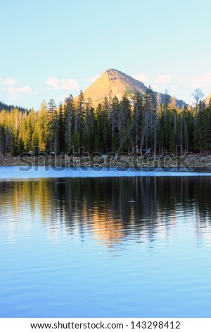 Utah mountains and forest reflecting in a lake, USA.