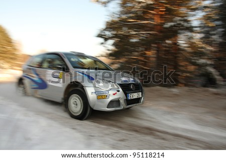 "UTENA, LITHUANIA - JANUARY 28: Ile-racing.lv team Volkswagen Polo car during ""Halls Winter Rally 2012"", on January 28, 2012 in Utena, Lithuania"