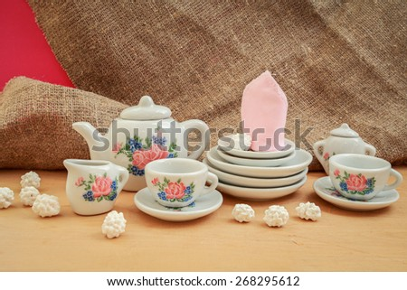 utensil crockery dishes toy mug saucer tea kettle laying set Tea Party - stock photo